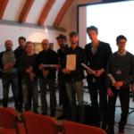 Foto di gruppo dei partecipanti presenti in sala.
