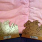 Le statuette in premio con l'ormai famoso logo realizzato per Cinegiovani dalla disegnatrice Ellekappa.